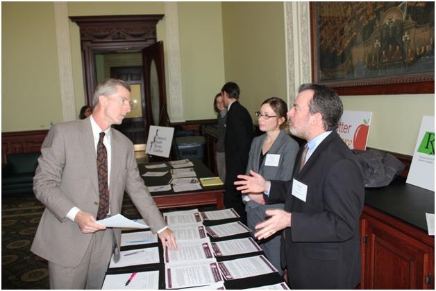 Representative Thomas P. Conroy talks with HCFA staff members.
